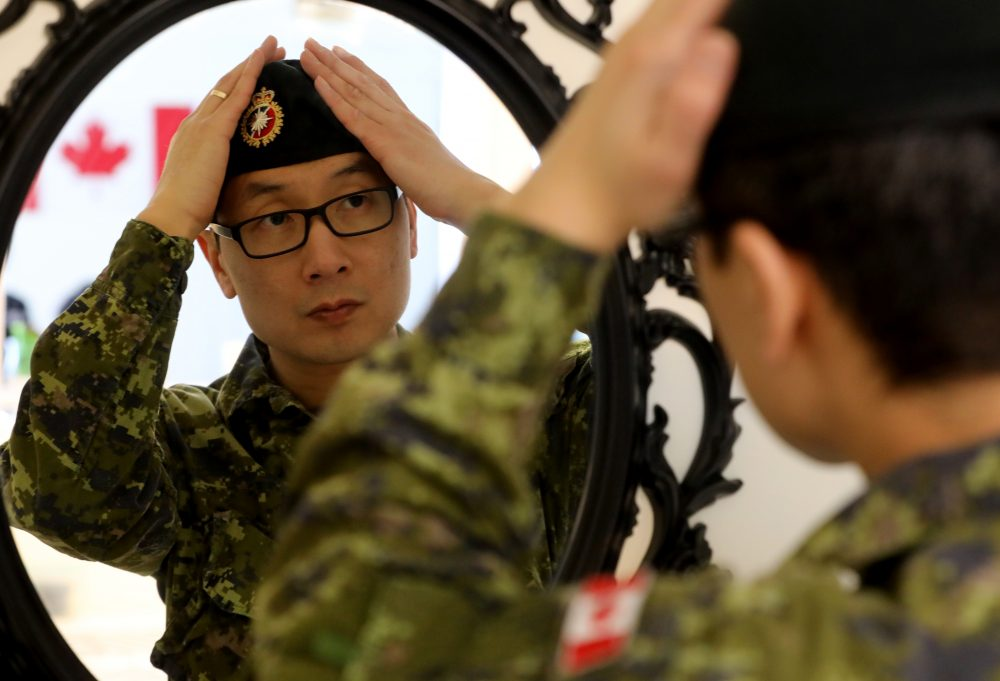 f9b54e6f685181 BELLEVILLE Ont. (12 02 19) — Salute to flag day YongIl Kim from CFB Trenton  wears his beret at his home in Belleville on Tuesday. He came to Canada to  study ...